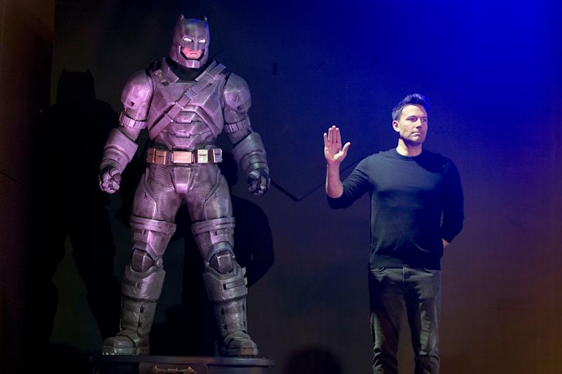 "Actor Ben Affleck poses with a statue of Batman during a press conference for the movie ""Batman v Superman: Dawn of Justice"" in Beijing, China, Friday, March 11, 2016. (AP Photo/Ng Han Guan)"