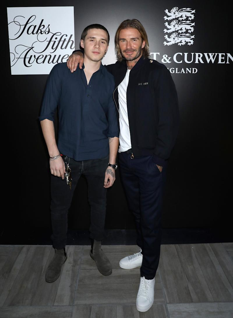 Brooklyn Beckham and David Beckham attends the 'Autumnal British Garden Party' from Kent & Curwen England hosted by David Beckham and Creative Director Daniel Kearns on September 11, 2017 in New York City.