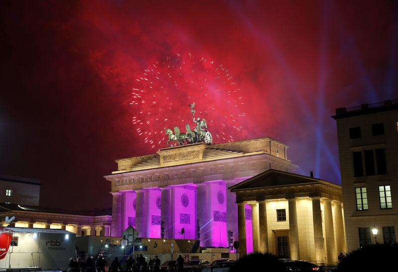 FILE PHOTO:Fireworks explode next to the Quadriga sculpture atop the Brandenburg gate during New Year celebrations in Berlin