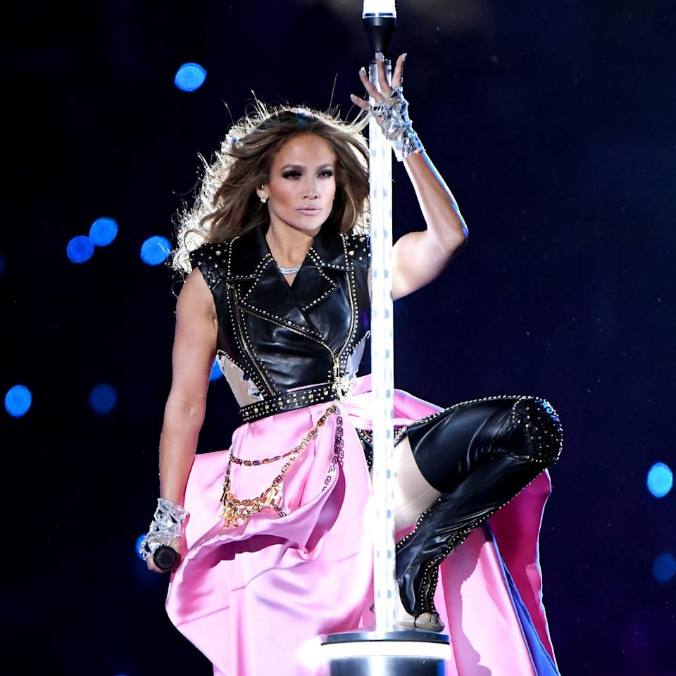 The singer ripped off her pink skirt to reveal a leather bodysuit [Photo: Getty]