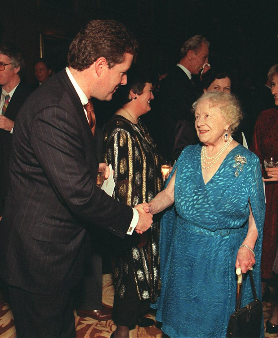 Piers Morgan chatting with the Queen Mother at Prince Philip's 50th birthday party. Source: Getty