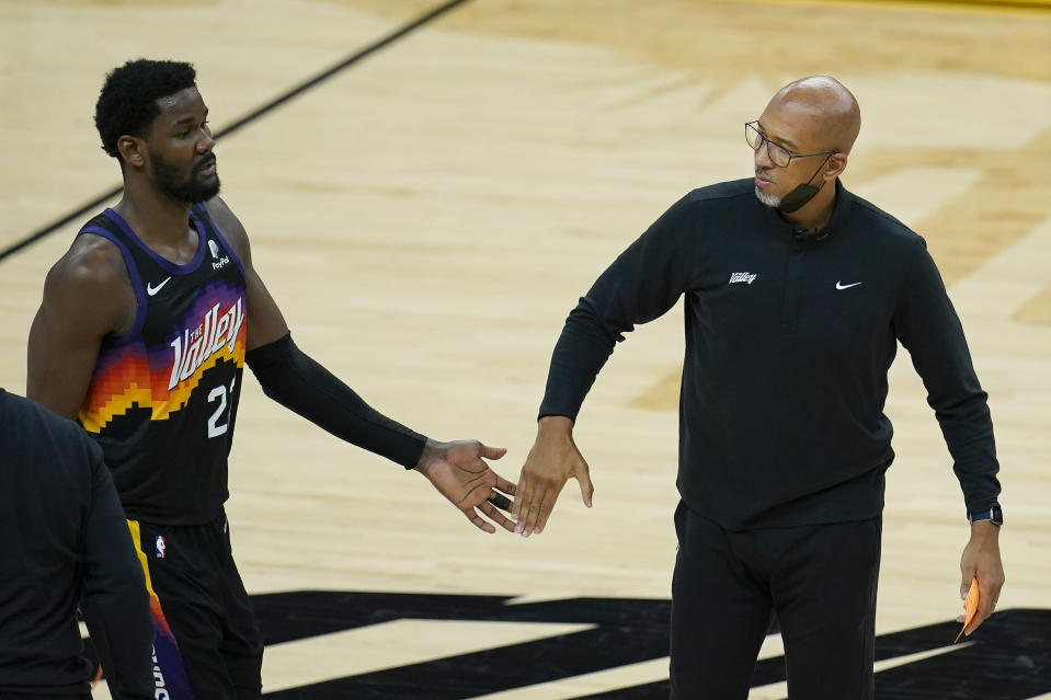 Phoenix Suns center Deandre Ayton, left, reacts with head coach Monty Williams during the first half of Game 2 of basketball's NBA Finals against the Milwaukee Bucks, Thursday, July 8, 2021, in Phoenix. (AP Photo/Ross D. Franklin)