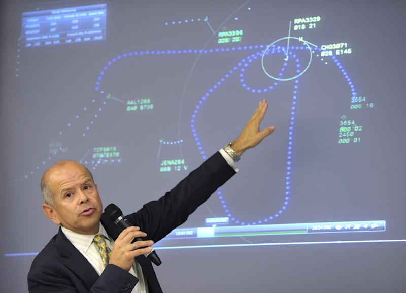 Acting Federal Aviation Administration (FAA) Administrator Michael Huerta comments on a graphic of air traffic control during a news conference at the Transportation Department in Washington, Thursday, Aug. 2, 2012. The news conference was held to answer question about three commuter jets that nearly collided at Reagan National Airport in Washington on Tuesday. (AP Photo/Susan Walsh)