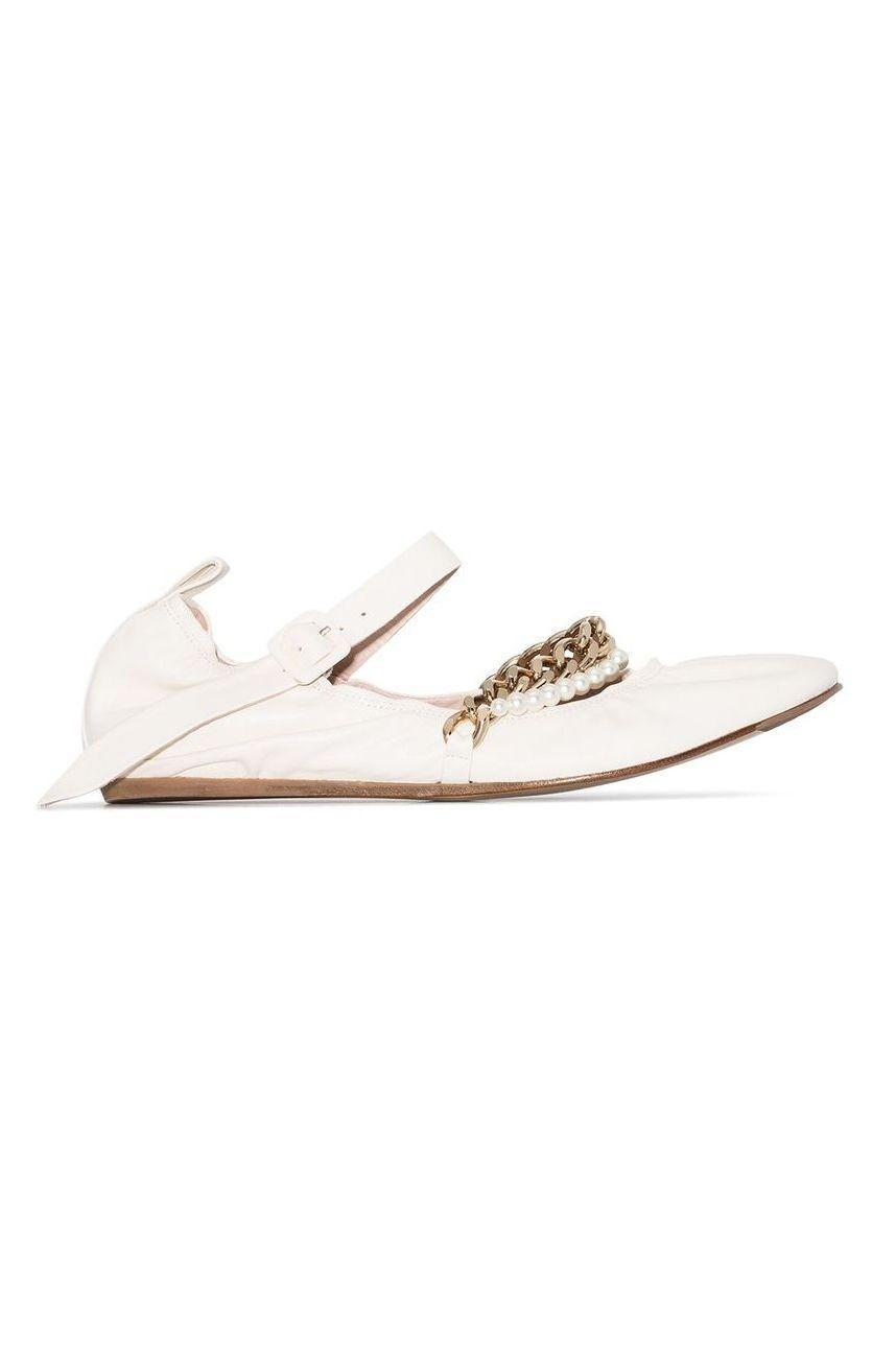 """<p><strong>Simone Rocha</strong></p><p>farfetch.com</p><p><strong>$565.00</strong></p><p><a href=""""https://go.redirectingat.com?id=74968X1596630&url=https%3A%2F%2Fwww.farfetch.com%2Fshopping%2Fwomen%2Fsimone-rocha-chain-detail-ballerina-shoes-item-15313790.aspx&sref=https%3A%2F%2Fwww.marieclaire.com%2Ffashion%2Fg34126792%2Fspring-shoe-trends-2021%2F"""" rel=""""nofollow noopener"""" target=""""_blank"""" data-ylk=""""slk:Shop Now"""" class=""""link rapid-noclick-resp"""">Shop Now</a></p><p>Simone Rocha's Spring offerings on the ballet flat may not be out for a few months but you can take these chain and pearl adorned version out for a spin now.</p>"""