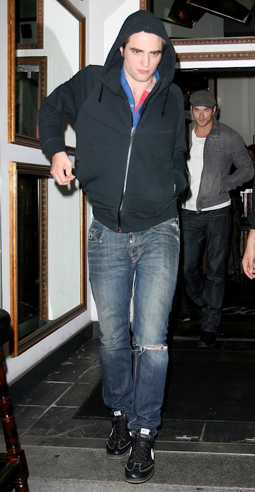 """Robert Pattinson and Kellan Lutz of """"The Twilight Saga: Eclipse"""" leave the Boneta restaurant in Vancouver, British Columbia, after a cast dinner. Miguel Aguilar/<a href=""""http://www.infdaily.com"""" target=""""new"""">INFDaily.com</a> - August 28, 2009"""