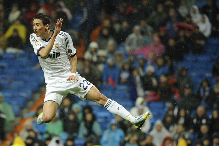 Real Madrid's Argentinian midfielder Angel di Maria jumps for the ball during the Spanish league football match Real Madrid vs Rayo Vallecano at the Santiago Bernabeu stadium in Madrid on February 17, 2012. Real Madrid won 2-0