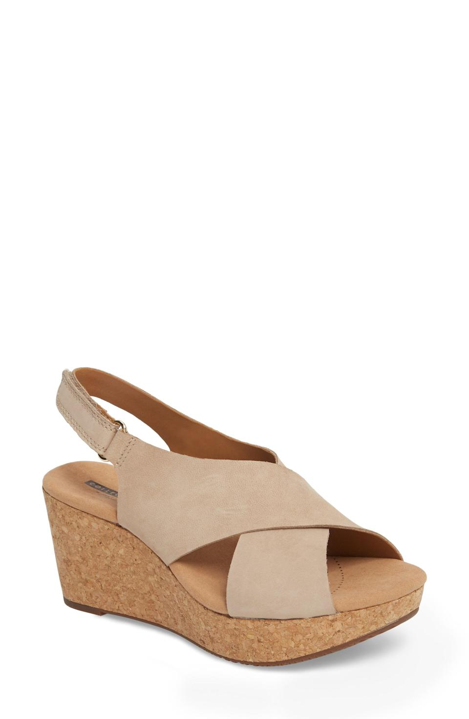 """<p><strong>Clarks</strong></p><p>nordstrom.com</p><p><strong>$69.95</strong></p><p><a href=""""https://go.redirectingat.com?id=74968X1596630&url=https%3A%2F%2Fwww.nordstrom.com%2Fs%2Fclarks-annadel-eirwyn-wedge-sandal-women%2F5634302&sref=https%3A%2F%2Fwww.prevention.com%2Fbeauty%2Fstyle%2Fg36040203%2Fcomfortable-wedge-sandals%2F"""" rel=""""nofollow noopener"""" target=""""_blank"""" data-ylk=""""slk:SHOP NOW"""" class=""""link rapid-noclick-resp"""">SHOP NOW</a></p><p>Cork wedges are known for offering <strong>great cushioning and shock absorption</strong>—and that's exactly what you'll get with this pair from Clarks (a brand known for comfy shoes). The cushioned footbed will support your feet all day long, and the leather straps won't pinch. </p>"""