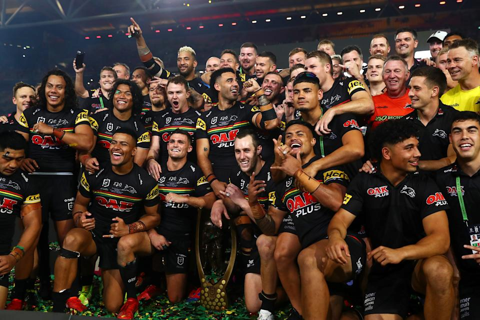 Seen here, Panthers players pose with the NRL Premiership Trophy after their 14-12 victory over the Rabbitohs.