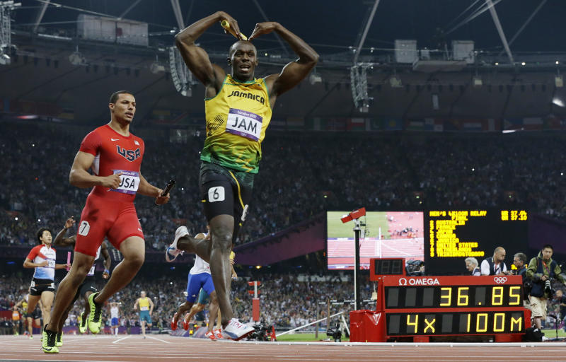 Jamaica's Usain Bolt celebrates his win in the men's 4 x 100-meter relay final during the athletics in the Olympic Stadium at the 2012 Summer Olympics, London, Saturday, Aug. 11, 2012. Jamaica set a new world record with a time of 36.84 seconds.(AP Photo/Anja Niedringhaus)