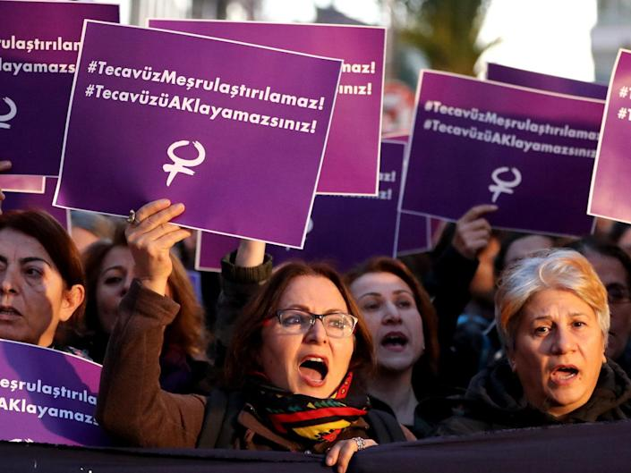 Turkish female protesters shout slogans against the government while holding placards reading 'Rape cannot be legalised': EPA