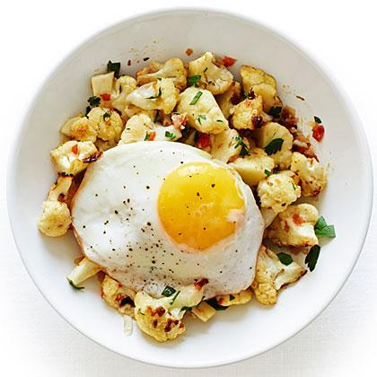 """<p>Cooked sunny side up or over easy, the egg's yolk becomes a rich sauce for the <a href=""""https://www.myrecipes.com/t/vegetables/cauliflower"""" rel=""""nofollow noopener"""" target=""""_blank"""" data-ylk=""""slk:cauliflower"""" class=""""link rapid-noclick-resp"""">cauliflower</a>.</p>"""