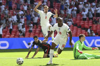 England's Raheem Sterling celebrates after scoring his side's opening goal during the Euro 2020 soccer championship group D match between England and Croatia at Wembley stadium in London, Sunday, June 13, 2021. (Glyn Kirk/Pool Photo via AP)