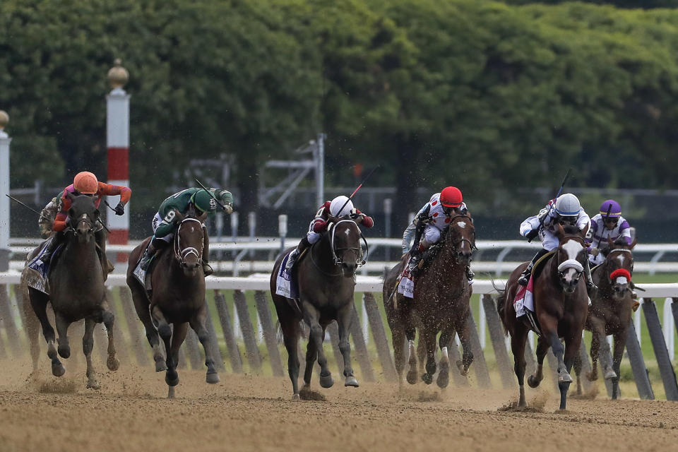 Tiz the Law (8), with jockey Manny Franco up, second from right, leads the pack down the home stretch during the152nd running of the Belmont Stakes horse race, Saturday, June 20, 2020, in Elmont, N.Y. Tiz the Law won the race. (AP Photo/Seth Wenig)