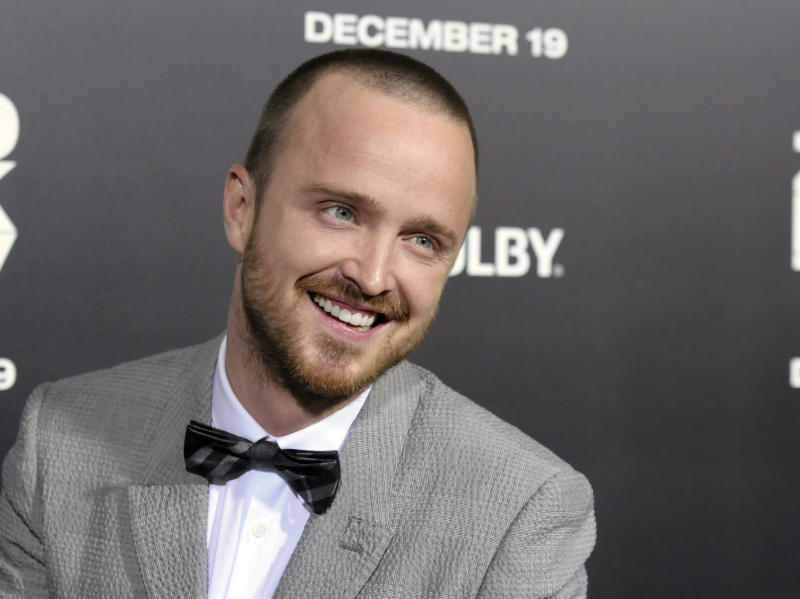 "FILE - This Dec. 10, 2012 file photo shows actor Aaron Paul at the premiere of the film ""Zero Dark Thirty"" in Los Angeles. Paul and rapper Drake appeared on stage Monday, June 10, 2013, at Electronic Arts' E3 presentation to promote games from the video game publisher. Drake hyped the next edition of the soccer simulator ""FIFA 14,"" while Paul teased the racing game ""Need for Speed: Rivals."" Paul stars in a film based on the ""Need for Speed"" series. (Photo by Dan Steinberg/Invision/AP, file)"