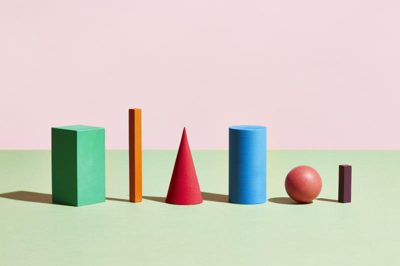 A row of geometric blocks of different shapes and colours. Photo: Getty