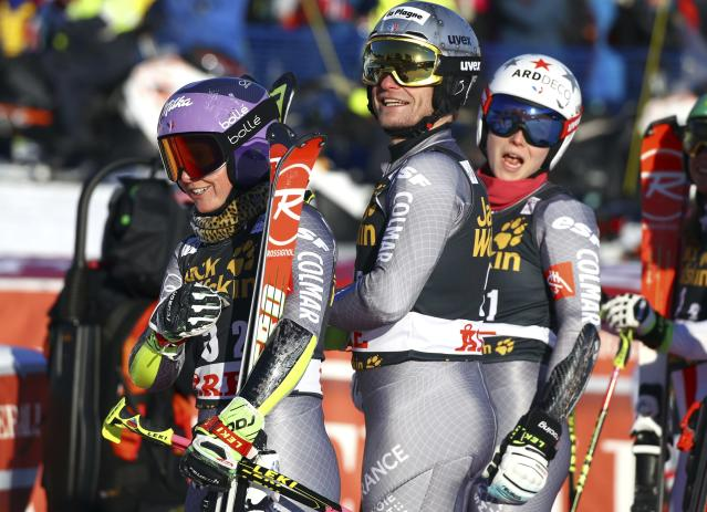 From left, France's Tessa Worley, Julien Lizeroux and Romane Miradoli stand in the finish area of the Team Event, at the alpine ski World Cup finals in Are, Sweden, Friday, March 16, 2018. France finished in second place. (AP Photo/Marco Trovati)