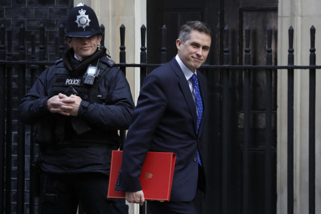 Gavin Williamson, here ahead of the budget being announced in Parliament in London says that schools should send home pupils who have a continuous cough or fever.(AP)