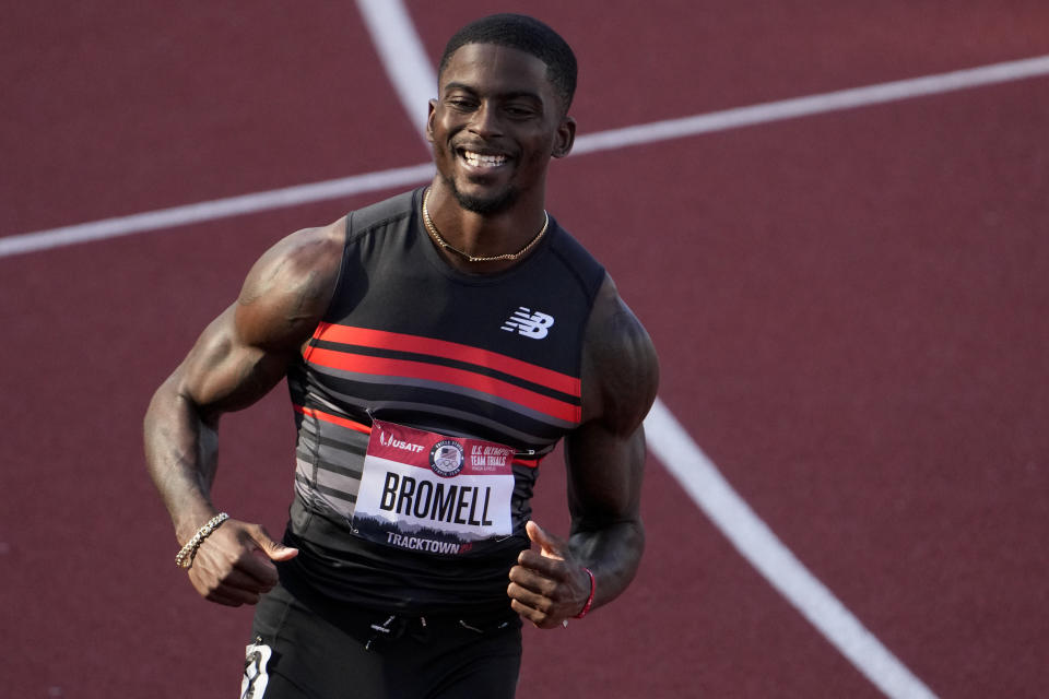 FILE - In this June 19, 2021, file photo, Trayvon Bromell wins the second heat of the men's 100-meter run at the U.S. Olympic Track and Field Trials in Eugene, Ore. The man positioned to take over the sprint game in the post-Usain Bolt world is Bromell. He's a 26-year-old American who is as unassuming as he is fast. (AP Photo/Chris Carlson, File)