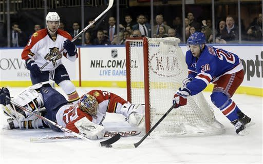 Florida Panthers goalie Jacob Markstrom (35) stops a shot on the goal by New York Rangers' Chris Kreider (20) during the second period of an NHL hockey game Thursday, March 21, 2013, in New York. (AP Photo/Frank Franklin II)
