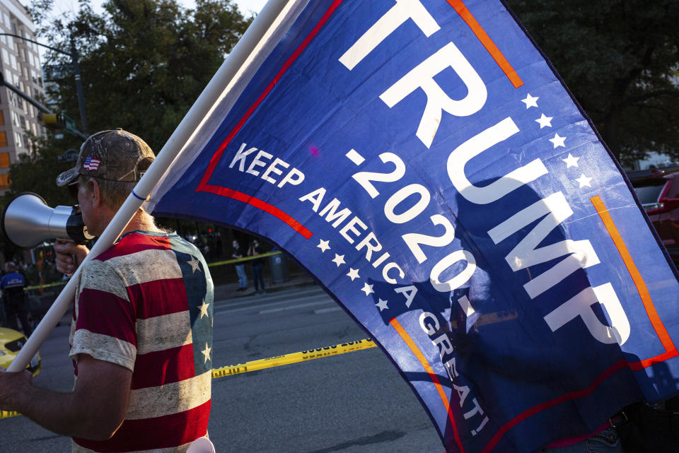 Supporters of President Donald Trump and Presidential-elect Joe Biden gather near the Texas Capitol after it was announced that Biden had won the presidential election, in Austin, Nov. 7, 2020. (Tamir Kalifa/The New York Times)