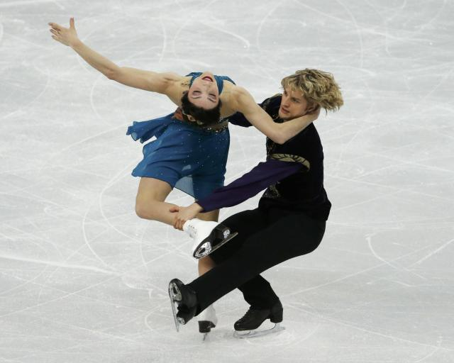 Meryl Davis and Charlie White of the United States figure skating team compete during the Team Ice Dance Free Dance at the Sochi 2014 Winter Olympics, February 9, 2014. REUTERS/David Gray (RUSSIA - Tags: SPORT FIGURE SKATING SPORT OLYMPICS)