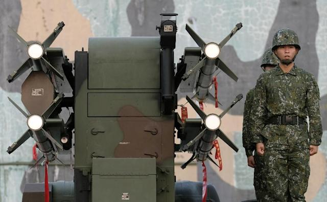 Taiwan soldiers stand next to home-made Tien Chien surface-to-air missiles during an annual drill in Tainan on January 17, 2017 (AFP Photo/Sam YEH)