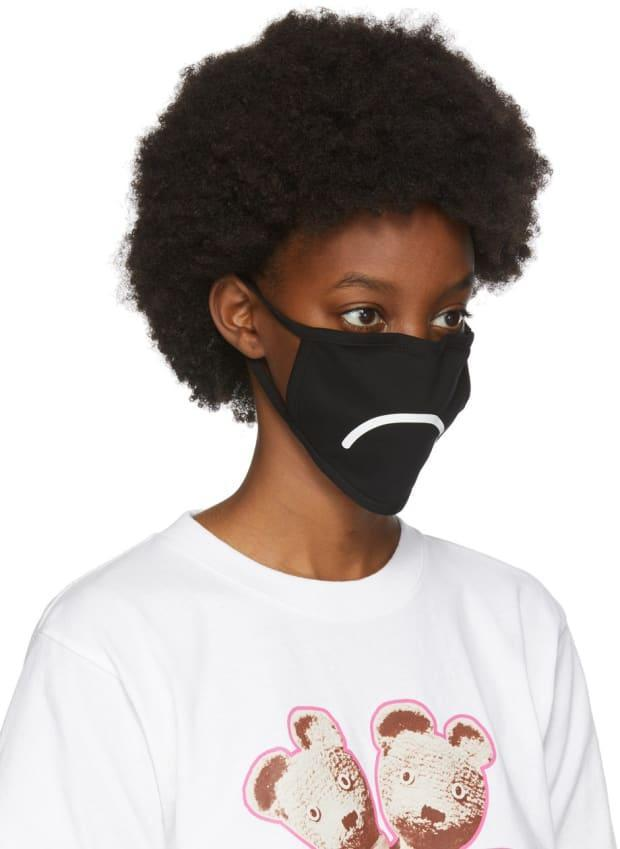 """<p>Marc Jacobs Three-Pack Black Smiley Face Masks, $23 from $55), <a href=""""https://rstyle.me/+pfOC61iP8bw20WRu8LWnLg"""" rel=""""nofollow noopener"""" target=""""_blank"""" data-ylk=""""slk:available here"""" class=""""link rapid-noclick-resp"""">available here</a>. </p>"""