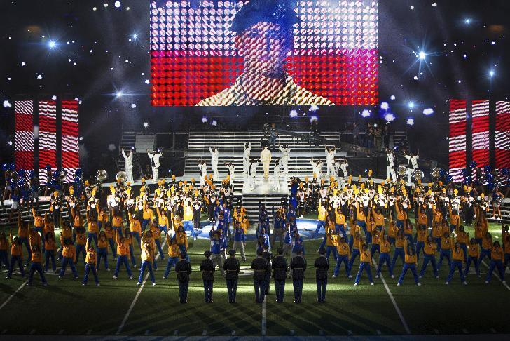 """This image released by Sony Pictures shows Joe Alwyn, portraying Billy Lynn, on a screen in a scene from the film, """"Billy Lynn's Long Halftime Walk,"""" in theaters on November 11.  The film will only be screened at 120 fps at two specially equipped theaters in North America. (Mary Cybulski/Sony-TriStar Pictures via AP)"""