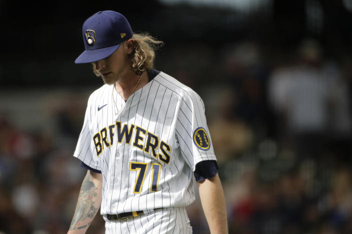 Milwaukee Brewers' Josh Hader walks to the dugout after being taken out of the game during the ninth inning of a baseball game against the Cincinnati Reds Sunday, July 11, 2021, in Milwaukee. (AP Photo/Aaron Gash)