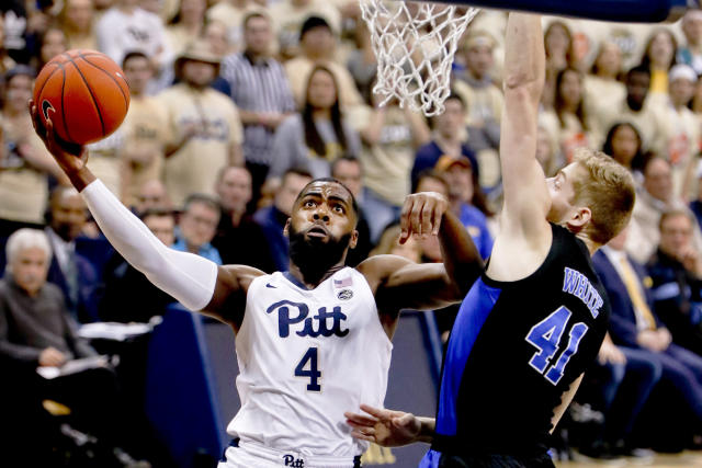 Pittsburgh's Jared Wilson-Frame (4) shoots as Duke's Jack White (41) defends during the first half of an NCAA college basketball game, Tuesday, Jan. 22, 2019, in Pittsburgh. (AP Photo/Keith Srakocic)