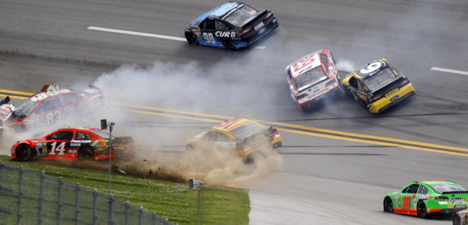 Cars spin through Turn one in a multi-car wreck during the NASCAR Sprint Cup Series Aaron's 499 auto race at Talladega Superspeedway in Talladega, Ala., Sunday, May 5, 2013. Pictured is: Tony Stewart (14), David Reutimann (83), Jeff Burton (31), Kevin Harvick (29), Marcos Ambrose (9) and Danica Patrick (10). (AP Photo/Butch Dill)