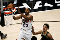 Phoenix Suns forward Deandre Ayton (25) scores as Atlanta Hawks guard Trae Young (11) defends in the first half of an NBA basketball game Wednesday, May 5, 2021, in Atlanta. (AP Photo/John Bazemore)