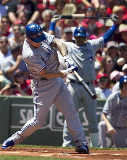 Toronto Blue Jays' Brett Lawrie hits a home run off a pitch by Boston Red Sox's Jon Lester in the first inning of a baseball game at Fenway Park, in Boston, Sunday, July 22, 2012. (AP Photo/Steven Senne)