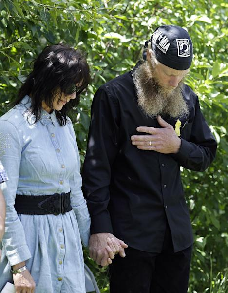 "Bob Bergdahl, right, and wife, Jani, the parents of captive U.S. Army Sgt. Bowe Bergdahl, hold in hands as they pray at the ""Bring Bowe Back"" celebration held to honor Sgt. Bergdahl in Hailey, Idaho, Saturday, June 22, 2013. Hundreds of activists for missing service members gathered in a small Idaho town Saturday to hear the parents of the only known U.S. prisoner of war speak just days after his Taliban captors announced they want to exchange him for prisoners being held at Guantanamo Bay. (AP Photo/Jae C. Hong)"