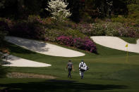 Patrick Cantlay walks to the 13th green during a practice round for the Masters golf tournament on Monday, April 5, 2021, in Augusta, Ga. (AP Photo/Charlie Riedel)
