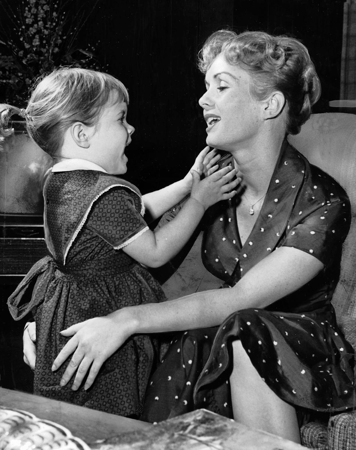 Debbie Reynolds with 3-year-old Carrie at home onNovember 16, 1959, in Los Angeles.