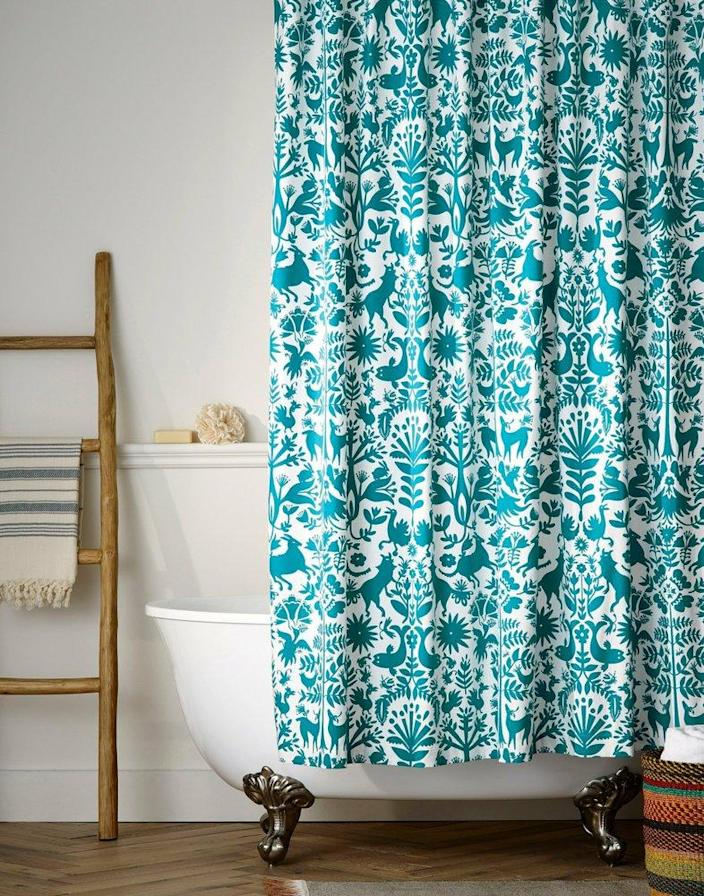 This Hygge & West Otomi shower curtain brings to color to the bathroom.