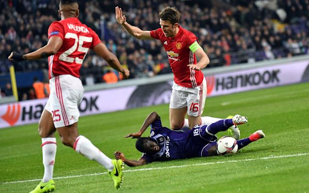 <span>Michael Carrick is tackled by Anderlecht's Frank Acheampong</span> <span>Credit: AP </span>