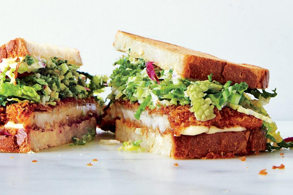 """A vinegary cabbage slaw is the perfect topping for a sandwich of crispy chicken thigh cutlets. <a href=""""https://www.epicurious.com/recipes/food/views/chicken-cutlet-sandwiches-with-savoy-cabbage-slaw-56389858?mbid=synd_yahoo_rss"""" rel=""""nofollow noopener"""" target=""""_blank"""" data-ylk=""""slk:See recipe."""" class=""""link rapid-noclick-resp"""">See recipe.</a>"""