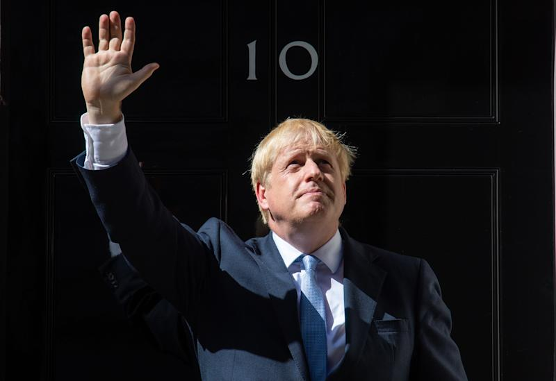 New Prime Minister Boris Johnson waves on the steps of 10 Downing Street, London, after meeting Queen Elizabeth II and accepting her invitation to become Prime Minister and form a new government.