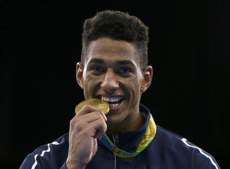 2016 Rio Olympics - Boxing - Victory Ceremony - Men's Super Heavy (+91kg) Victory Ceremony - Riocentro - Pavilion 6 - Rio de Janeiro, Brazil - 21/08/2016. Gold medallist Tony Yoka (FRA) of France poses with his medal. REUTERS/Peter Cziborra