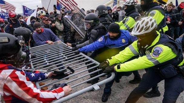 PHOTO: Violent insurrectionists loyal to President Donald Trump try to break through a police barrier at the Capitol in Washington, Jan. 6, 2021. (John Minchillo/AP, FILE)