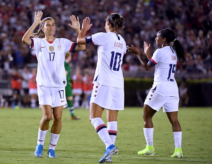 Carli Lloyd #10 of the United States celebrates her goal with Tobin Heath #17 and Crystal Dunn #19, to take a 3-0 lead over the Republic of Ireland, during the first half of the first game of the USWNT Victory Tour at Rose Bowl on August 03, 2019 in Pasadena, California. | Harry How—Getty Images