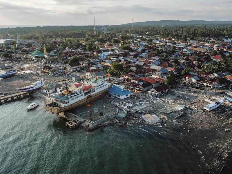 A ship stranded amid destruction after an earthquake and tsunami hit Indonesia, near the mouth of the Sulawesi island. Image: Reuters