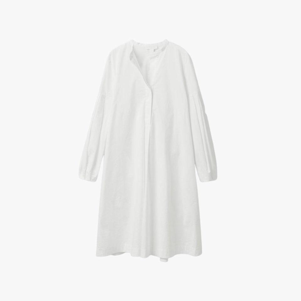 "$115, COS. <a href=""https://www.cosstores.com/en_usd/women/womenswear/dresses/product.pleated-shirt-dress-white.0973697002.html"" rel=""nofollow noopener"" target=""_blank"" data-ylk=""slk:Get it now!"" class=""link rapid-noclick-resp"">Get it now!</a>"