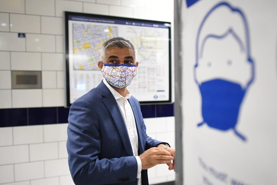 Sadiq Khan urged commuters to continue to wear face masks (PA Wire)