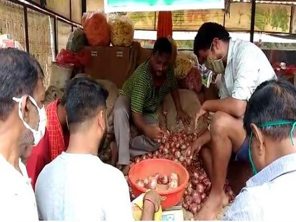 Onions being sold at Visakhapatnam's Rythu Bazaar. (Photo/ANI)