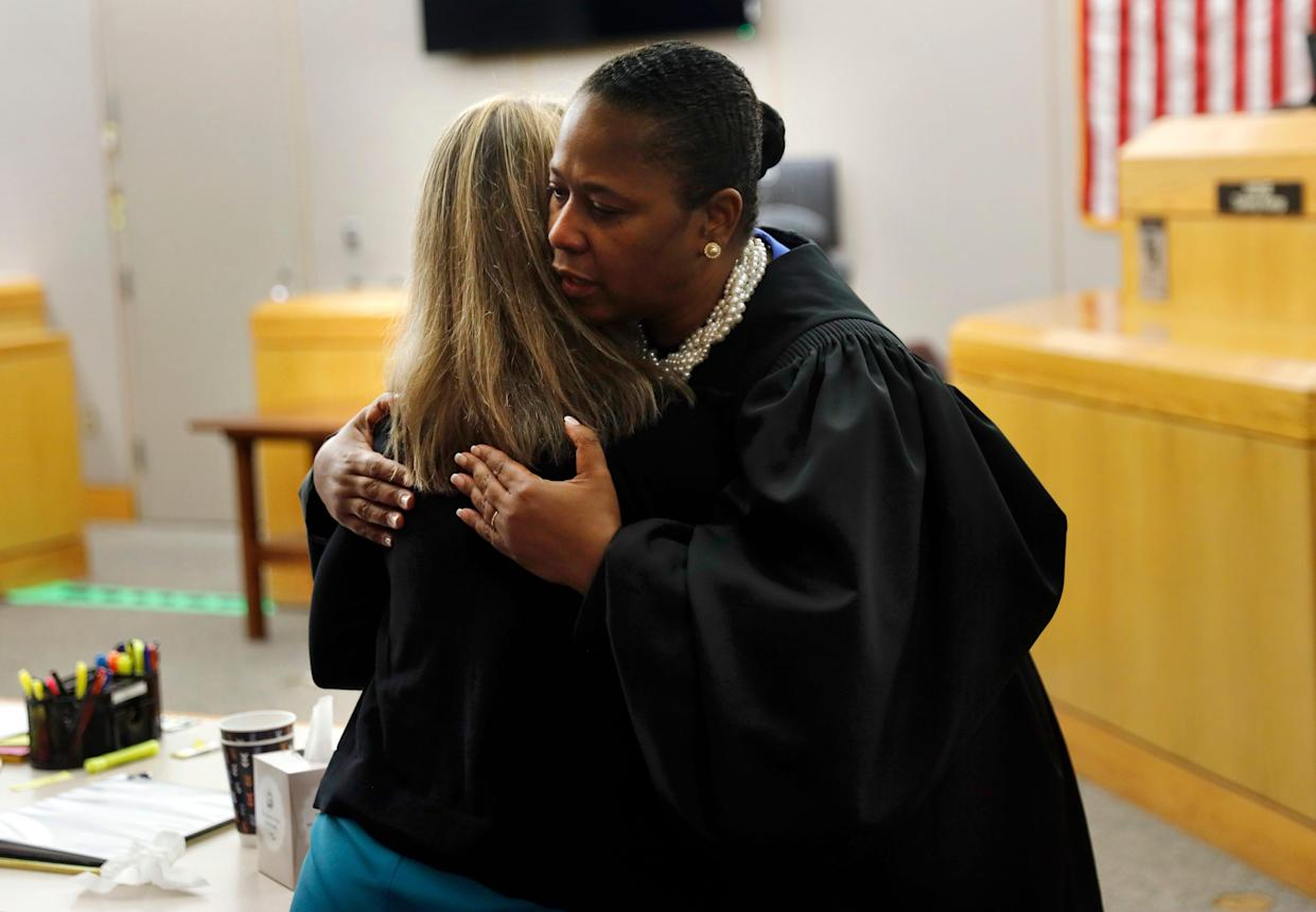 State District Judge Tammy Kemp gives former Dallas Police Officer Amber Guyger a hug before Guyger leaves for jail, Wednesday, Oct. 2, 2019, in Dallas. Guyger, who said she mistook neighbor Botham Jean's apartment for her own and fatally shot him in his living room, was sentenced to a decade in prison.