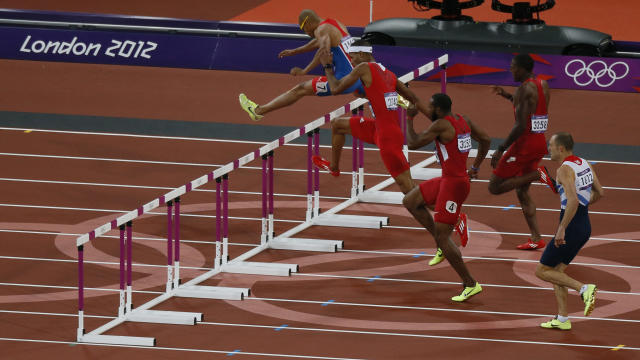 Felix Sanchez (L) of the Dominican Republic clears a hurdle as he competes in the men's 400m hurdles final during the London 2012 Olympic Games at the Olympic Stadium August 6, 2012. REUTERS/Stefan Wermuth (BRITAIN - Tags: OLYMPICS SPORT ATHLETICS)