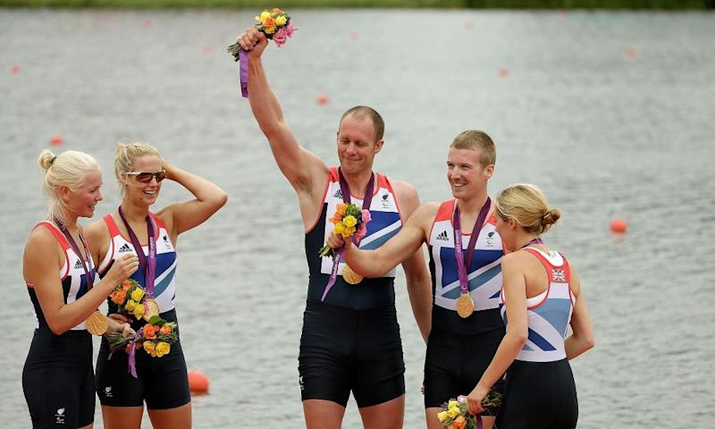David Smith (centre) and the rest of the British mixed coxed four rowing team in 2012.